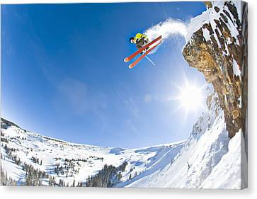 Freestyle Skier Jumping Off Cliff Canvas Print by Tyler Stableford