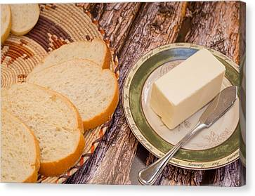Fresh Bread And Butter Canvas Print by Jon Manjeot
