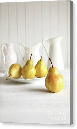 Fresh Pears On Old Table Canvas Print by Sandra Cunningham