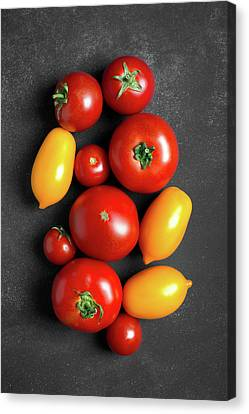 Fresh Tomatoes At The Center Of Chalkboard  Canvas Print by Vadim Goodwill