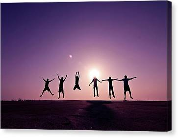Friends Jumping Against Sunset Canvas Print by Kazi Sudipto photography