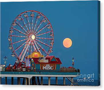 Full Moon Rising Above The Gulf Of Mexico - Historic Pleasure Pier - Galveston Island Texas Canvas Print by Silvio Ligutti