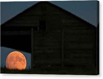 Full Moon Seen Through Old Building Window Canvas Print by Mark Duffy
