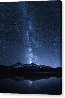 Galaxies Reflection Canvas Print by Toby Harriman