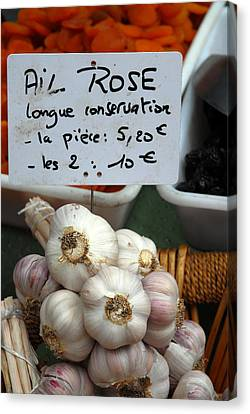Garlic And Dried Apricots For Sale Canvas Print by Anne Keiser