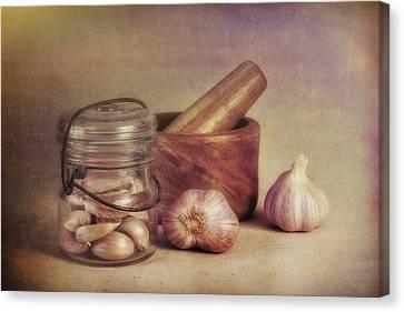 Garlic In A Jar Canvas Print by Tom Mc Nemar