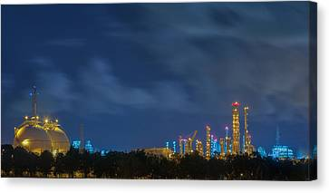 Gas Storage Tanks And A Large Oil-refinery Plant Canvas Print by Anek Suwannaphoom