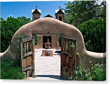 Gate Of An Adobe Church Canvas Print by George Oze