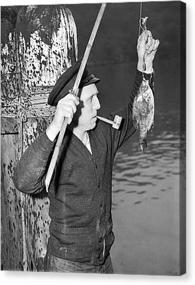 German Crewman Fishes In Sf Canvas Print by Underwood Archives