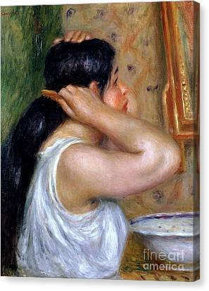 Girl Combing Her Hair Canvas Print by Pierre Auguste Renoir