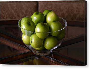 Glass Bowl Of Green Apples  Canvas Print by Michael Ledray