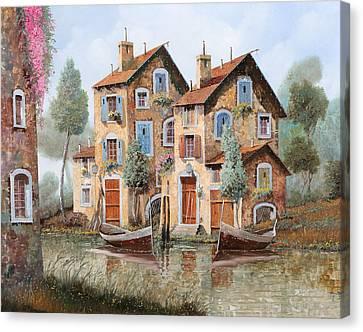 Gocce Sulle Case Canvas Print by Guido Borelli