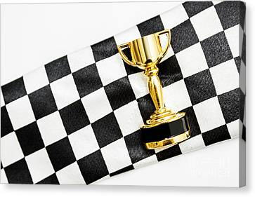 Gold Trophy On A Checked Sport Flag Canvas Print by Jorgo Photography - Wall Art Gallery