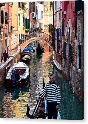 Gondola Ride Through Venice Canvas Print by Frozen in Time Fine Art Photography