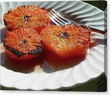 Grapefruit Brulee With Pomegranate Liqueur Canvas Print by James Temple