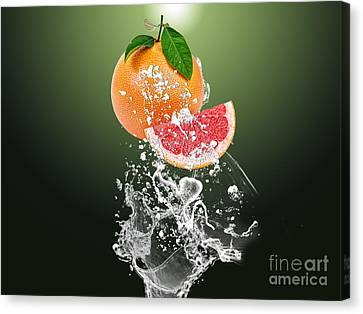 Grapefruit Splash Canvas Print by Marvin Blaine
