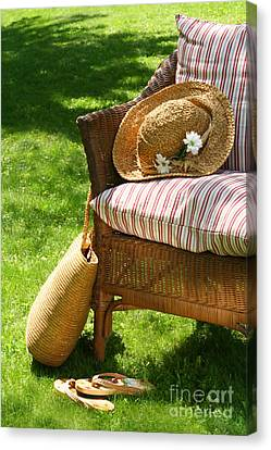 Grass Lawn With A Wicker Chair  Canvas Print by Sandra Cunningham