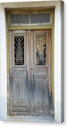 Greek Door With Wrought Iron Window Canvas Print by Maria Varnalis