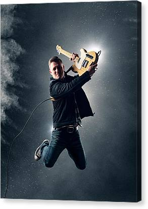 Guitarist Jumping High Canvas Print by Johan Swanepoel