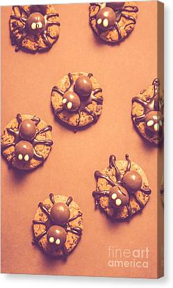 Halloween Spider Cookies On Brown Background Canvas Print by Jorgo Photography - Wall Art Gallery