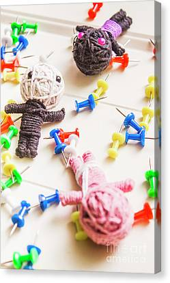Handmade Knitted Voodoo Dolls With Pins Canvas Print by Jorgo Photography - Wall Art Gallery