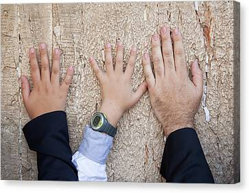 Hands Of Dad And Son On The Wailing Wall, Jerusalem Canvas Print by Yoel Koskas