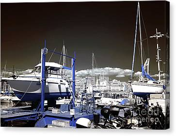 Hanging Boats Canvas Print by John Rizzuto