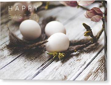 Happy Easter Card With Eggs And Magnolia On The Wooden Background Canvas Print by Aldona Pivoriene
