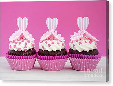 Pink And White Cupcakes. Canvas Print by Milleflore Images