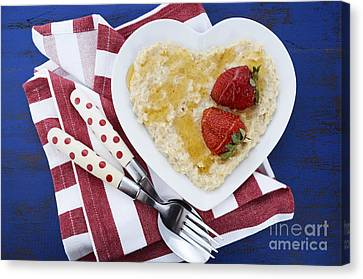 Healthy Breakfast Oats On Heart Shape Plate Canvas Print by Milleflore Images