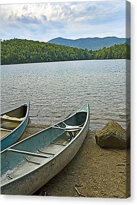Heart Lake Canoes In Adirondack Park New York Canvas Print by Brendan Reals