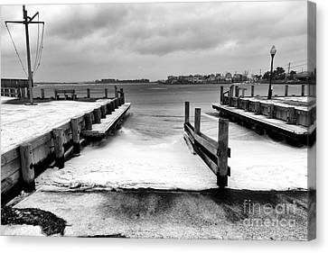 Ice In The Bay Canvas Print by John Rizzuto