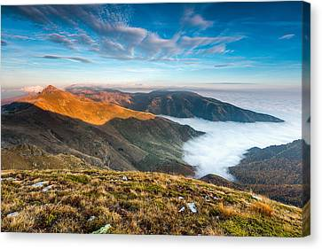 Island In The Lake Of Clouds Canvas Print by Evgeni Dinev