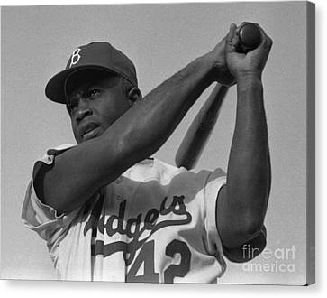 Jackie Robinson Swinging A Bat In Dodgers Uniform Canvas Print by Celestial Images