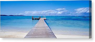 Jetty On The Beach, Mauritius Canvas Print by Panoramic Images