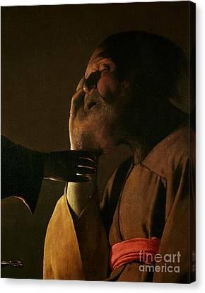 Joseph And The Angel Canvas Print by Georges de la Tour