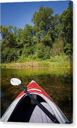 Kayak On A Forested Lake Canvas Print by Steve Gadomski