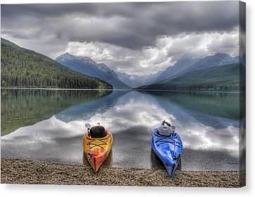 Kayaks On Bowman Lake Canvas Print by Donna Caplinger