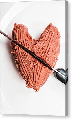 Knife Cutting Heart Shape Chocolate On Plate Canvas Print by Jorgo Photography - Wall Art Gallery