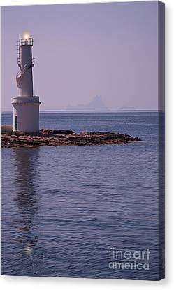 La Sabina Lighthouse Formentera And The Island Of Es Vedra Canvas Print by John Edwards