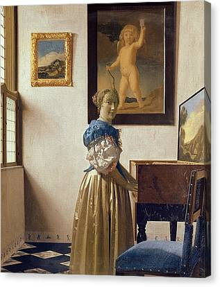 Lady Standing At The Virginal Canvas Print by Jan Vermeer