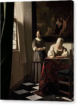 Lady Writing A Letter With Her Maid Canvas Print by Jan Vermeer