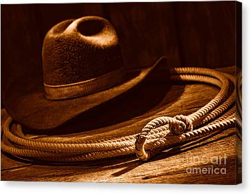 Lariat And Hat - Sepia Canvas Print by Olivier Le Queinec
