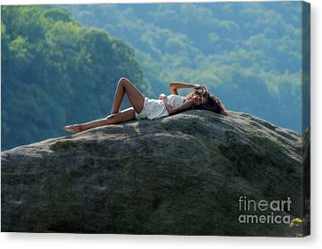 Laying On Top Of The Boulder Canvas Print by Dan Friend