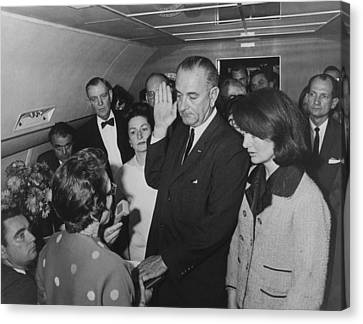 Lbj Taking The Oath On Air Force One Canvas Print by War Is Hell Store