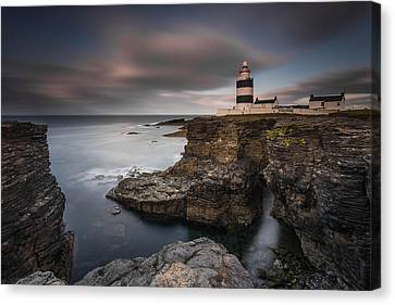 Lighthouse On Cliffs Canvas Print by Grzegorz Wanowicz