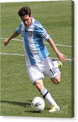 Lionel Messi Kicking Canvas Print by Lee Dos Santos