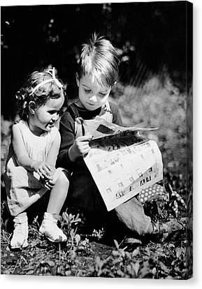 Little Boy & Girl Reading Comic Strips Outside Canvas Print by George Marks