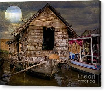 Living On The River Canvas Print by Adrian Evans