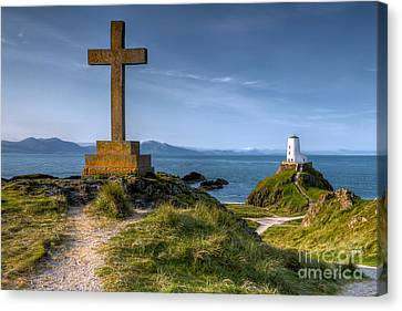 Llanddwyn Cross Canvas Print by Adrian Evans